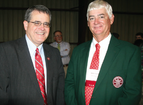 At right, Philip Grimes, Swisher Sweets/Sunbelt Expo Southeastern Farmer of the Year, is pictured with University of Georgia President Jere Morehead.