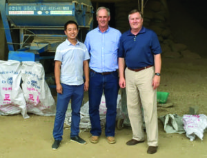 John Crumpler, Va. member (middle), and NPB President and CEO, Bob Parker (right) met with the owner of a local peanut shelling company while attending the International Peanut Conference.